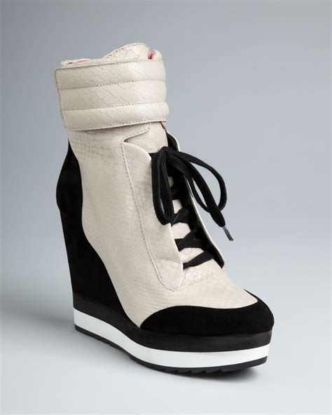 high top wedge sneakers lyst boutique 9 high top wedge sneaker booties whispers