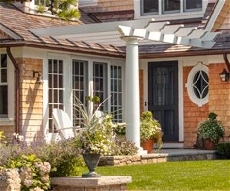 attach pergola to house roof construction details