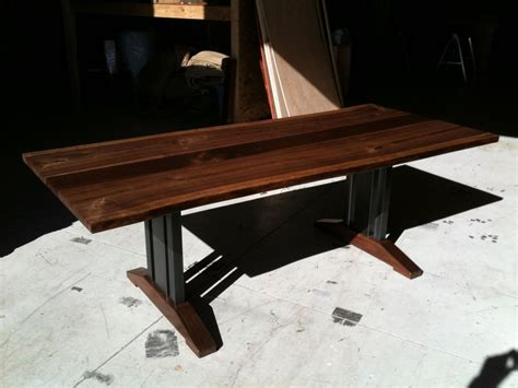 hand made live edge walnut dining table tressel legs by