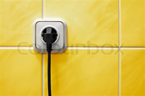 bathroom plug socket wall outlet with a electric plug in a bathroom stock