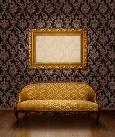 frame pattern on wall classic antique sofa and gold plated frame in room with