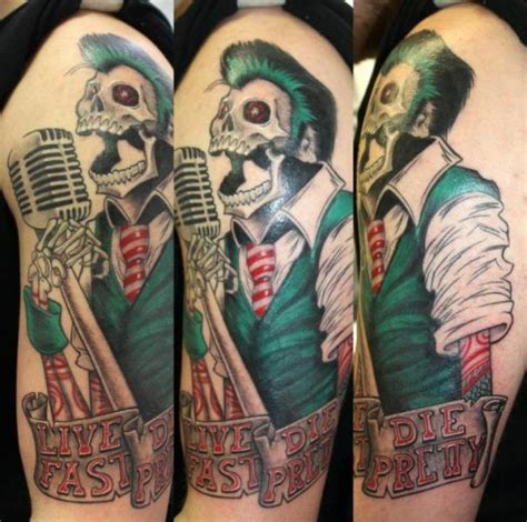 shoulder microphone skeleton tattoo by herzstich tattoo