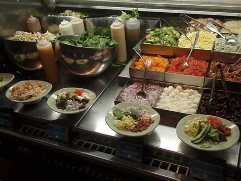 you pick em salad station at the buffet picture of