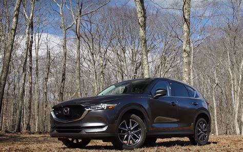 comparison mazda cx  grand touring   volvo xc  hybrid  suv drive