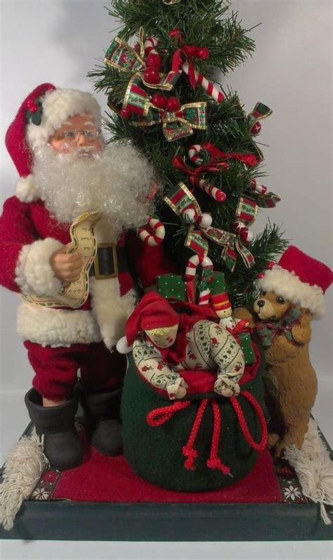 santacruz with christmas tree animated vintage 1993 creations animated musical motionette santa claus puppy searching for