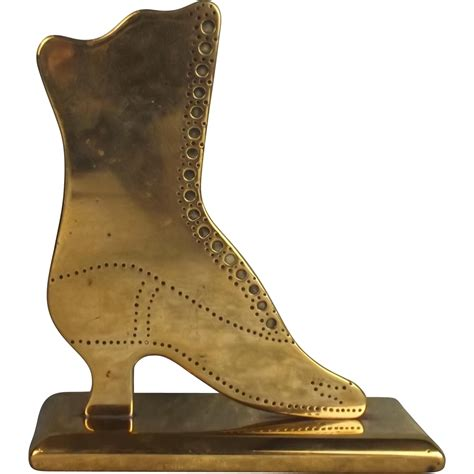 boot shaped boer war era brass boot shaped trench paper weight