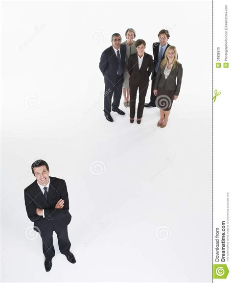appart from businessman standing apart from group stock photo image 31838970