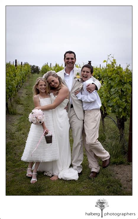 a family for the rancher cowboys to grooms books family picture in front of vineyards of and groom