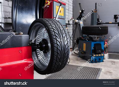 balancing for car tires car wheel balancing in tire service stock photo 456428887