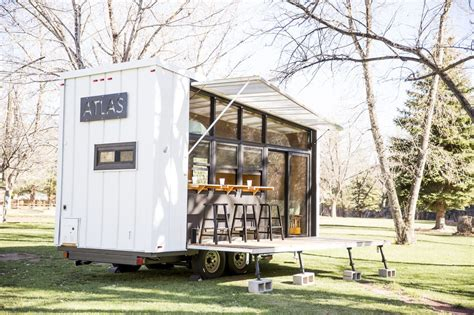 tiny house for two folding walls open to reveal a surprisingly bright and