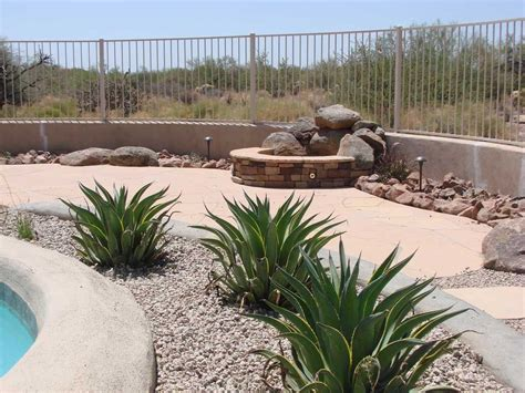 desert backyard landscape theme swimming pool side photo