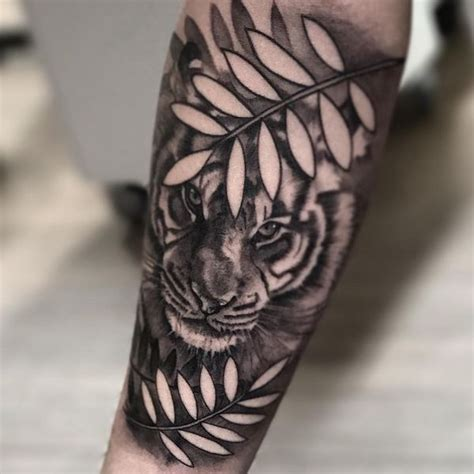 tiger forearm tattoo 60 awesome tiger designs with meanings