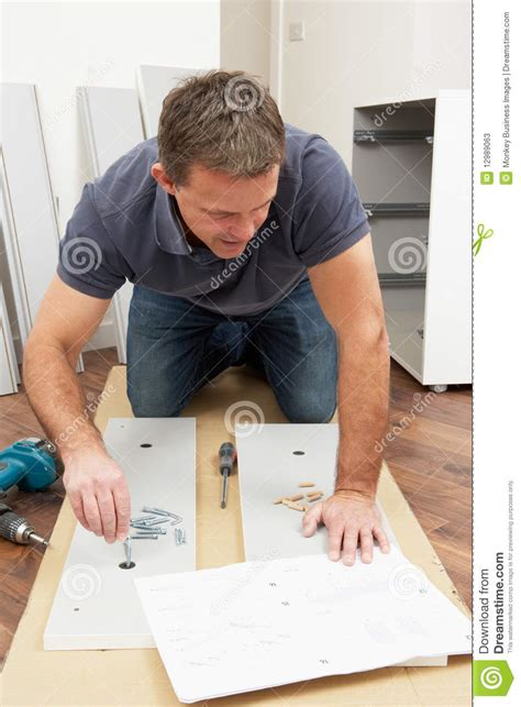 in house furniture movers man assembling flat pack furniture stock photos image 12989063