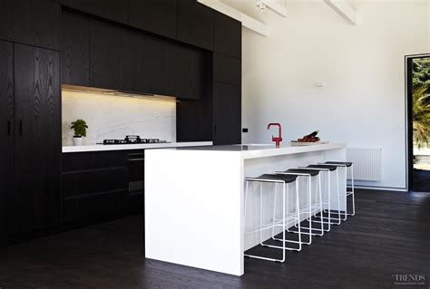 New Trends In Kitchen Cabinets contemporary black and white kitchen with dark stained