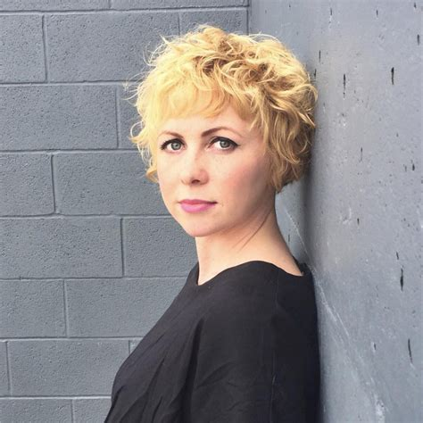 women s strawberry blonde shag with undone textured waves women s cropped blonde bob with curly textured fringe and