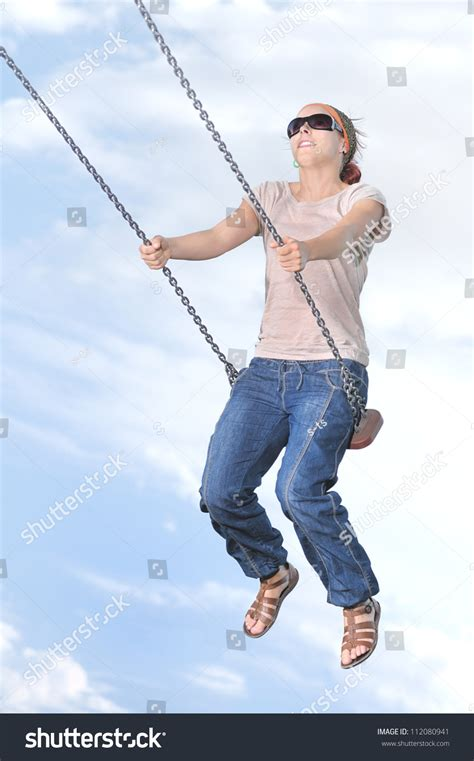 women and swinging woman swinging relaxing on swing set stock photo 112080941