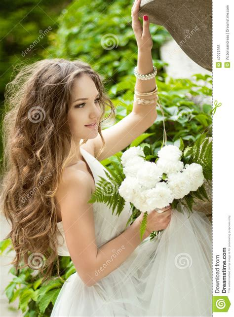 Beautiful Happy Bride With Long Wavy Hair And Wedding