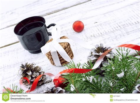 how many copies of a cup of christmas tea sold composition with decorated tree cup with coffee and c stock photo image 63712627