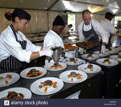 Banquet Chef by Chefs Working In Large Kitchen Preparing Banquet Dinner Stock Photo Royalty Free Image 916831