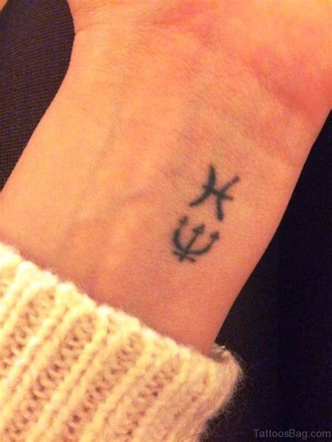small pisces tattoo 23 zodiac pisces tattoos on wrist