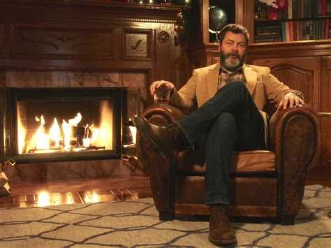 nick offerman drinking whiskey nick offerman makes own yule log video business insider