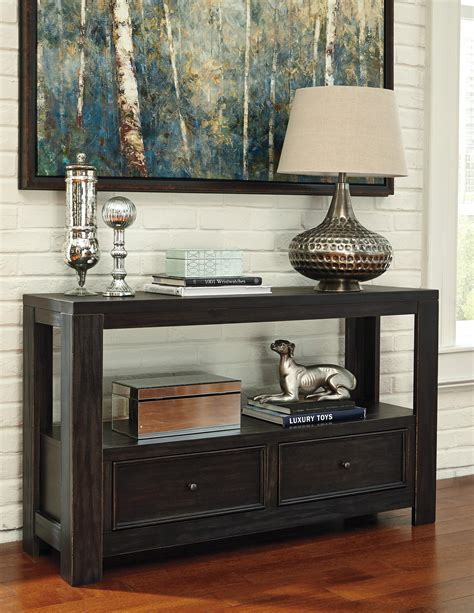 distressed sofa table with drawers signature design by gavelston rustic distressed