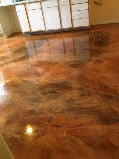 metallic marble floor done in a coffee and brass