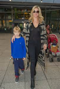Penny lancaster arrives at heathrow airport with 12 luggage cases that