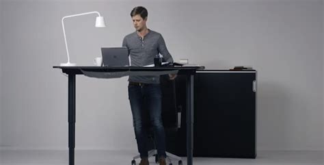 Raise A Desk by Raise Or Lower Your Desk With The Push Of A Button Cube