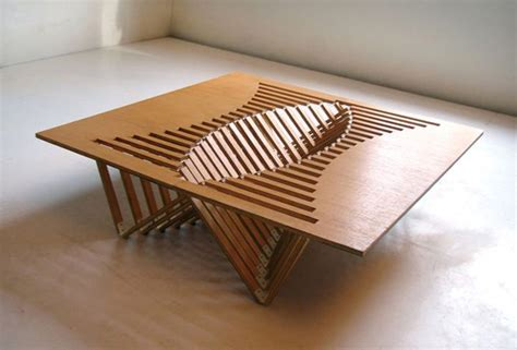 design table furniture with a figuratively beating heart rising table