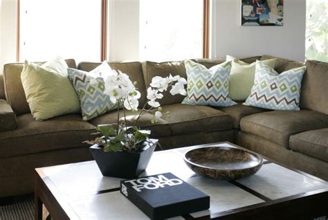brown couch pillow ideas trend alert karate chopped throw pillows bald