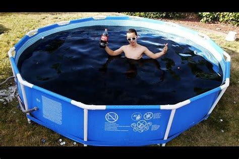 dude frolics in 1 500 gallon pool of coca cola adds