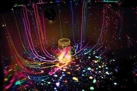 glow in the paint splatter neon paint gif