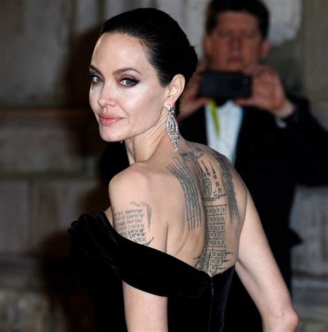 angelina jolie back tattoo s yant vihan pha chad sada back