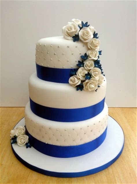 blue wedding cakes with flowers 3 tier stacked wedding cake with sapphire blue and