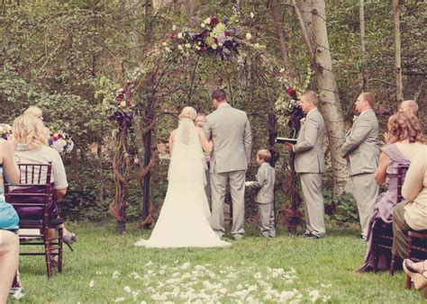 Rustic Wedding Arbor: Decorated with grapevine garland