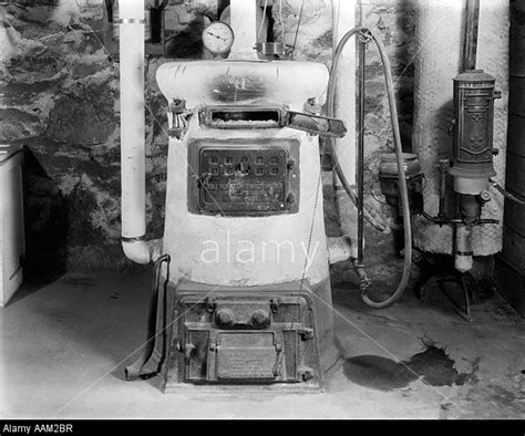 old hot water boiler 1920s old fashion coal burning home furnace and gas water