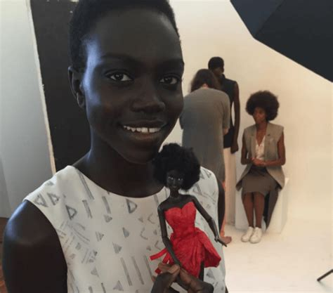 black doll with black doll maker has response after ignorant