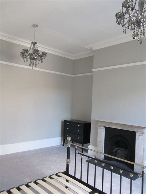 guest room farrow and pavilion grey walls and chandeliers i ll take both