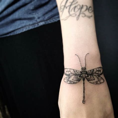 wrist tattoo care wrist of a dragonfly by saruzi