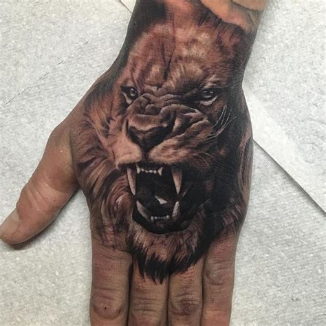 cool lion tattoo on hand