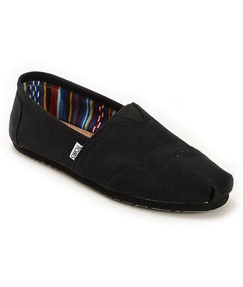 toms classics all black slip on mens shoes zumiez