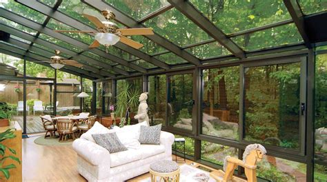 an iron roof and all glass walls 20 beautiful glass enclosed patio ideas