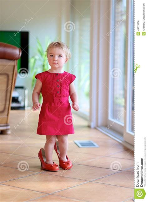 child high heels toddler walks at home in s shoes stock