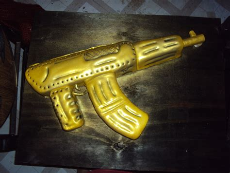 gold gun themes gold platted ak 47 machine gun cakecentral com