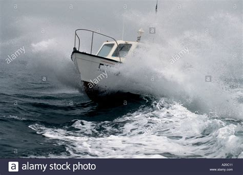 fishing boat in storm video a small fishing boat in a storm at sea stock photo
