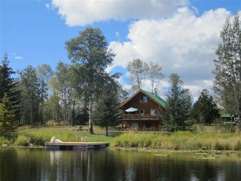 bc log home for sale on acreage with lake