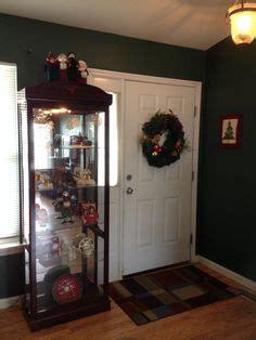 curio cabinet christmas decorating ideas christmas village in my curio cabinet holiday christmas