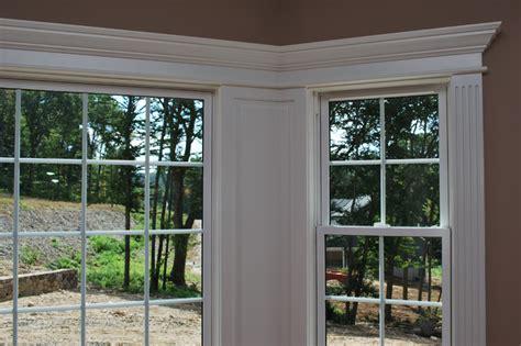 integrate window and door trim with wainscoting panels
