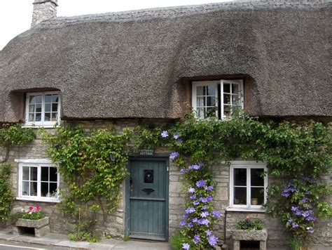 Thatched Cottages In by 67 Not Out Corfe Castle Where West And East Are In The Same Direction
